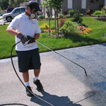 Sealcoating contractor using coal tar sealer